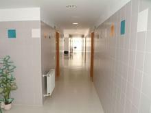 Colegio interno, pasillo de habitaciones
